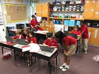5th graders helping 3rd graders